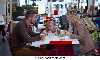 Nice family eat in the shopping mall