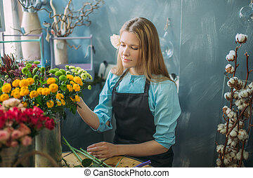nice female choosing fresher mimosas for bouquet indoors