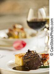 Nice fine steak dinner. - A fine steak dinner with a flower...