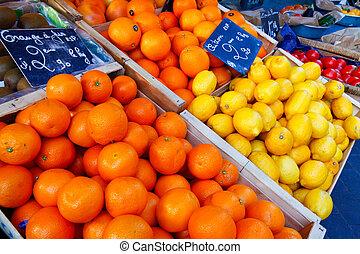 Nice, France - October 17, 2011: Juicy oranges and lemon, ...