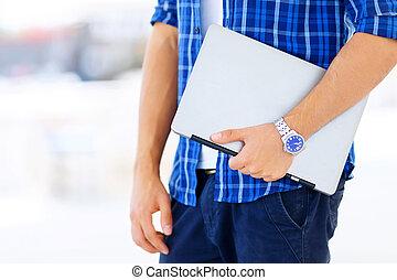 Nice freelancer holding notebook