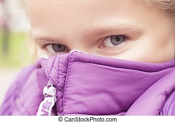 nice frozing girl hiding behind the purple vest