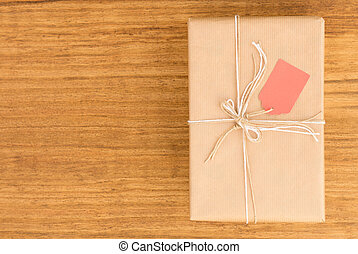 Nice gift wrapped with brown paper and decorated with white ...