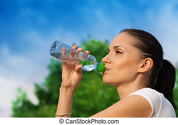 nice girl drinking water from bottle