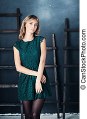Nice Girl in Fashion Green Dress. Studio Portrait