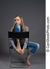 nice girl in jeans posing in studio