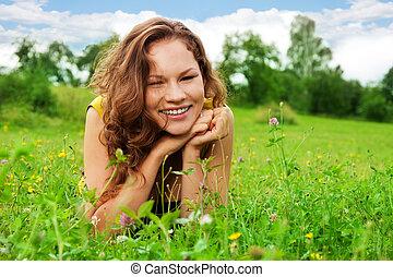 nice girl laying on green grass