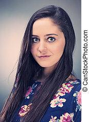 Nice girl on studio portrait