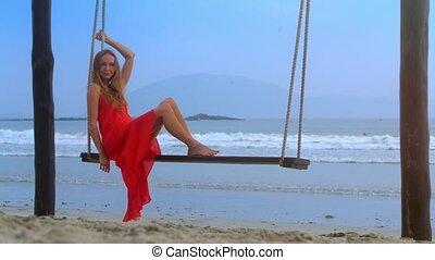 Nice Girl Sits on Bench Swings against Azure Ocean - nice...