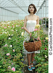 Nice girl - An image of a nice young girl in a greenhouse