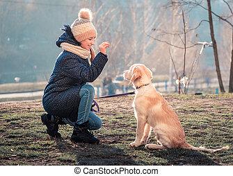 Nice girl training young dog