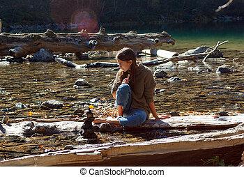 Nice Girl traveler on a mountain lake