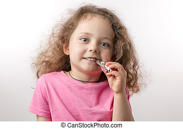 nice girl with red lonf curly hair is crazy about sweets