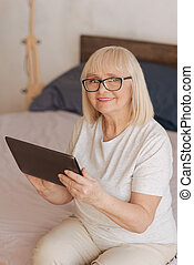 Nice good looking woman holding a tablet