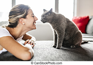 Nice Grey Cat with woman on sofa