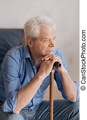 Nice grey haired man leaning on the walking stick - Old age....