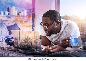 Nice handsome man working at home