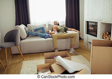 Nice happy boy lying on the sofa with dad