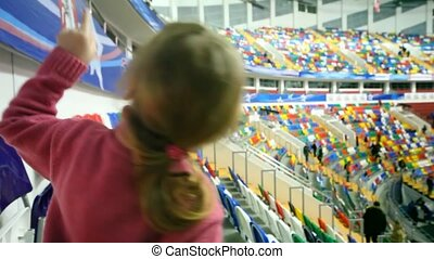 little girl cant wait for skating show to begin - Nice...