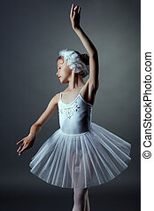 Nice little girl dancing role of White Swan - portrait of...