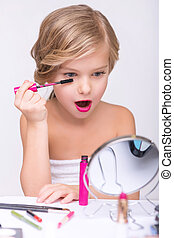Nice little girl doing make up