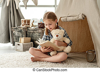 Nice little girl with paper book