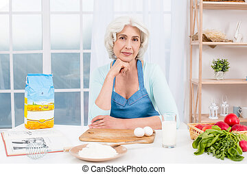 Nice looking adult woman at kitchen