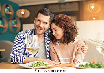 Nice looking couple in cafe - Date in cafe. Lovely couple in...