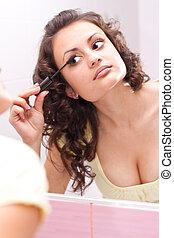 Nice looking girl doing makeup