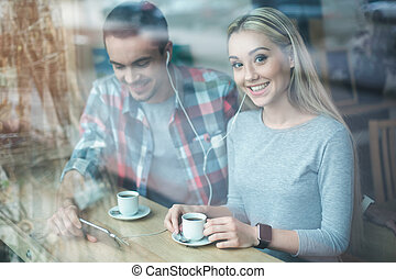 Nice looking man and woman in cafe