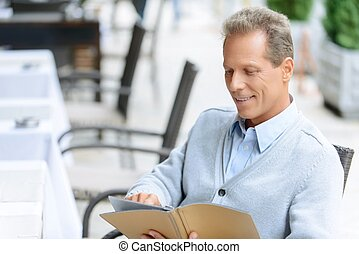 Nice man sitting at the table