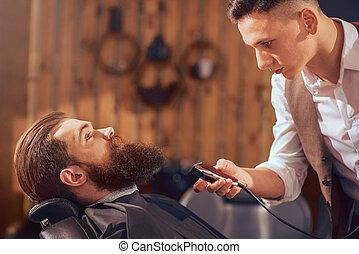 Nice man sitting in the barbershop - Fire away. Pleasant ...