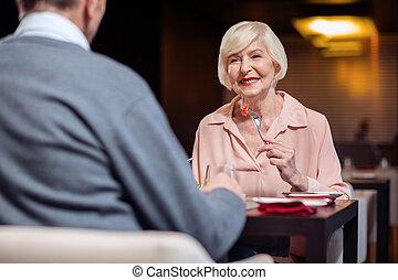 Nice mature woman eating salad