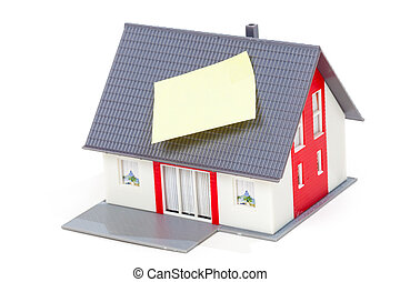 Nice model house with note on the roof isolated over white background