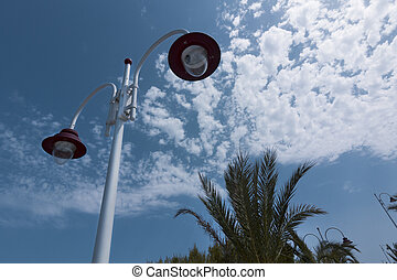 nice modern lamp on blue sky with clouds