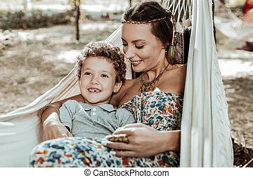 Nice mother and child having fun in hammock
