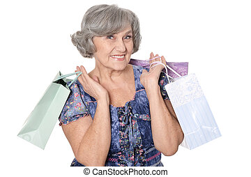 Nice old woman with shopping bag, isolated on white...