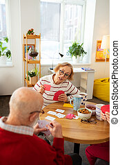 Nice pleasant elderly woman making her move