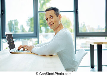 Nice pleasant man studying global market