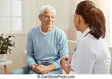 Nice pleasant man talking to the nurse