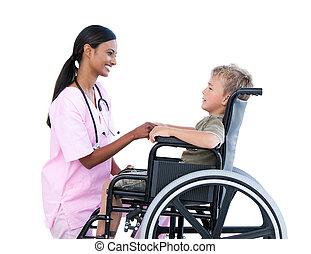 Nice portait nurse and sick child on wheelchair