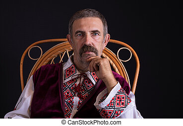 Ukrainian country-man sitting in a wicker chair