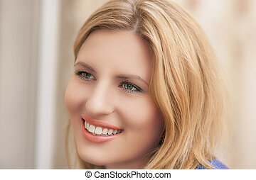 nice portrait of young smiling blond