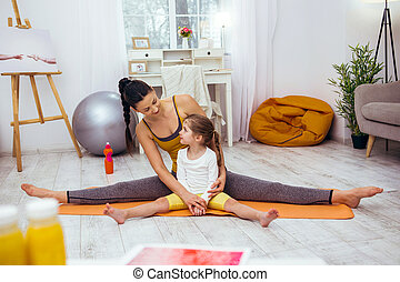 Nice positive girl learning to do the splits