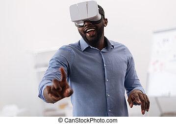 Nice positive man looking at the virtual screen