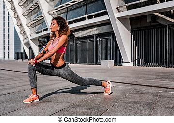 Nice positive slim woman enjoying her workout