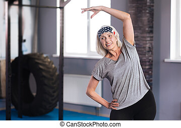Nice positive woman enjoying a physical activity