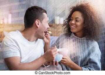 Nice pretty woman feeding her boyfriend