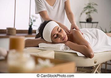 Nice pretty woman visiting spa salon
