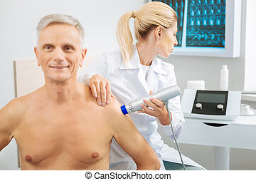 Nice professional doctor looking at the monitor